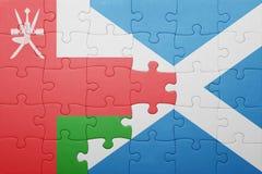 desconcierte con la bandera nacional de Omán y de Escocia Imágenes de archivo libres de regalías