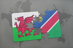 desconcierte con la bandera nacional de País de Gales y de Namibia en un mapa del mundo Fotografía de archivo