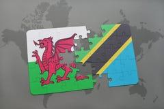 desconcierte con la bandera nacional de País de Gales y de Tanzania en un mapa del mundo Imagen de archivo