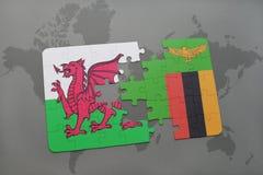 desconcierte con la bandera nacional de País de Gales y de Zambia en un mapa del mundo Imagen de archivo libre de regalías