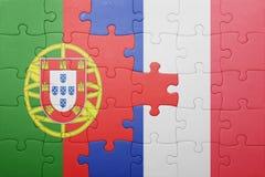Desconcierte con la bandera nacional de Portugal y de Francia Fotografía de archivo