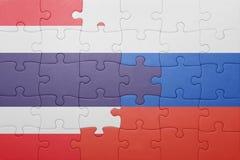 Desconcierte con la bandera nacional de Tailandia y de Rusia Imagen de archivo libre de regalías
