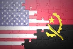Desconcierte con las banderas nacionales de los Estados Unidos de América y de Angola Fotos de archivo libres de regalías