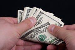 Desconte dentro a mão masculina Imagem de Stock Royalty Free