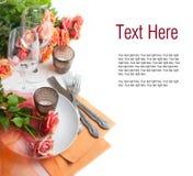 Descripteur avec la configuration de fête de table avec des roses Photo libre de droits