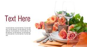 Descripteur avec la configuration de fête de table avec des roses Images stock