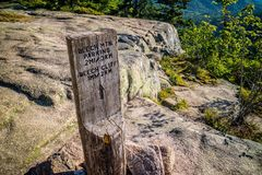 A description board for the trail in Acadia National Park, Maine. Acadia National Park, ME, USA - August 15, 2018: The Beech Cliff Trail royalty free stock photography