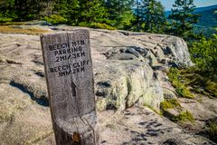 A description board for the trail in Acadia National Park, Maine. Acadia National Park, ME, USA - August 15, 2018: The Beech Cliff Trail stock images
