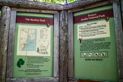 A description board for the trail in Acadia National Park, Maine. Acadia National Park, ME, USA - August 15, 2018: The Beehive Trail stock image