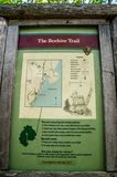 A description board for the trail in Acadia National Park, Maine. Acadia National Park, ME, USA - August 15, 2018: The Beehive Trail royalty free stock image