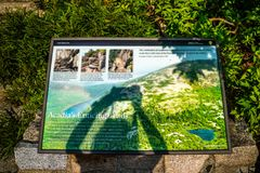 A description board for the trail in Acadia National Park, Maine. Acadia National Park, ME, USA - August 15, 2018: The Acadia Enticing Trails stock images