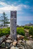 A description board for the trail in Acadia National Park, Maine. Acadia National Park, ME, USA - August 15, 2018: The Great Head Point of elevation stock image