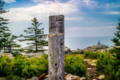 A description board for the trail in Acadia National Park, Maine. Acadia National Park, ME, USA - August 15, 2018: The Great Head Point of Elevation royalty free stock photos