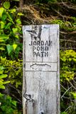 A description board for the trail in Acadia National Park, Maine. Acadia National Park, ME, USA - August 15, 2018: The Jordan Pond Path stock photo
