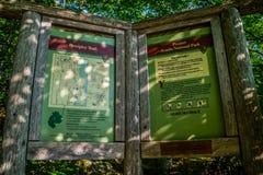 A description board for the trail in Acadia National Park, Maine. Acadia National Park, ME, USA - August 15, 2018: The Precipice Trail stock photo