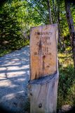 A description board for the trail in Acadia National Park, Maine. Acadia National Park, ME, USA - August 15, 2018: A signage post for different tourist royalty free stock photos