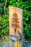 A description board for the trail in Acadia National Park, Maine. Acadia National Park, ME, USA - August 15, 2018: A signage post for different tourist royalty free stock photography
