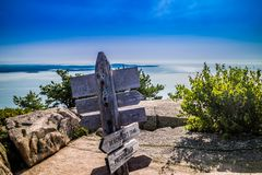 A description board for the trail in Acadia National Park, Maine. Acadia National Park, ME, USA - August 15, 2018: A signage post for different tourist stock image