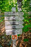A description board for the trail in Acadia National Park, Maine. Acadia National Park, ME, USA - August 15, 2018: A signage post for different tourist stock photos