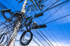 Electric pylon with caotic electric wiring Royalty Free Stock Image