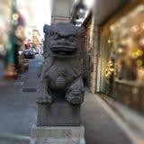Chinatown`s Dragon Gate, guardian female lion, 4. stock photo