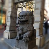 Chinatown`s Dragon Gate, guardian female lion, 5. stock photography