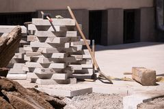 the process of laying paving stone on the street royalty free stock images