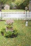 Desejo bem com flora Fotos de Stock Royalty Free