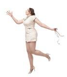 Desejo positivo da mulher do tamanho para algo com centímetro nas mãos Foto de Stock