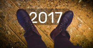 2017 desejos do ano novo contra botas pretas Fotografia de Stock Royalty Free