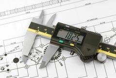 Desenhar com compassos de calibre Fotos de Stock Royalty Free