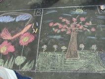 Desenhar no asfalto imagens de stock royalty free