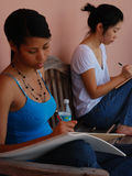 Desenhar preto e asiático das meninas Fotografia de Stock Royalty Free