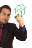 Desenho considerável novo do homem de negócios no whiteboard Fotografia de Stock