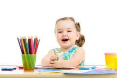Desenho da criança e fatura pelas mãos Fotografia de Stock Royalty Free
