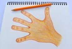 Desenho da mão esquerda no bloco de desenho no fundo do Livro Branco Foto de Stock Royalty Free