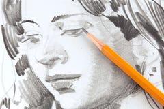 Desenho da menina pelo lápis da grafita fotografia de stock