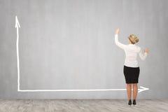 Desenho da mulher de negócio na parede Imagens de Stock