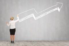 Desenho da mulher de negócio na parede Imagem de Stock