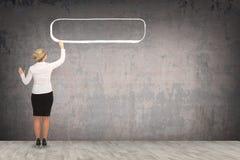 Desenho da mulher de negócio na parede Fotos de Stock