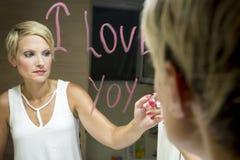 Desenho da mulher no espelho Foto de Stock