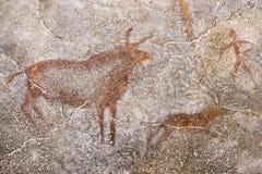 Desenho de animais antigos na parede da caverna fotografia de stock