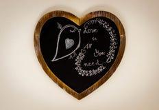 Desenho de giz da forma do coração - o amor é tudo que você precisa foto de stock royalty free