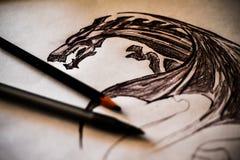 Desenho de lápis do dragão Fotos de Stock Royalty Free
