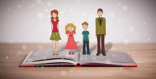 Desenho de uma família feliz no livro aberto Fotografia de Stock Royalty Free