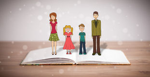 Desenho de uma família feliz no livro aberto Imagens de Stock Royalty Free