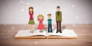Desenho de uma família feliz no livro aberto Fotos de Stock