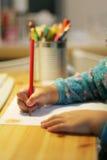 Desenho e escrita da criança Fotos de Stock