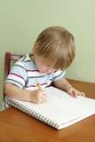 Desenho ou escrita da criança Imagem de Stock Royalty Free