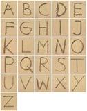Desenho ou escrita do alfabeto na areia fotografia de stock royalty free